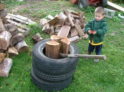 Wood splitting with old tires.