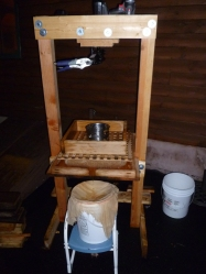 Homemade cider press with empty frame